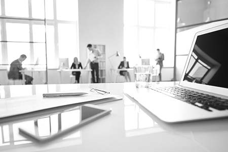 Business devices on table in office